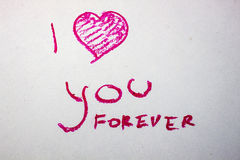 Inscription I love you forever lipstick. Inscription written in lipstick on a white background Royalty Free Stock Photo