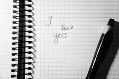 Inscription I love you in a notebook. Notepad in the cage, on the spring black and white Stock Images