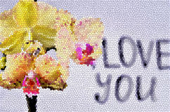 The inscription `I love you`. On the orchid is a gift - a wedding ring on the background of the inscription `I love you stock images