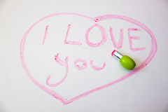 Inscription. I love you written in lipstick on a white background Royalty Free Stock Photography