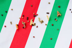 Inscription Italy on background of italian flag. Pasta in the form of letters Stock Photo