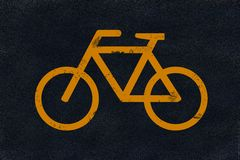 Inscription jaune sur l'asphalte noir Photographie stock