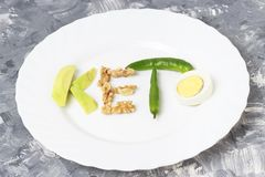 Inscription Keto made of nuts, eggs and avocado. Ketogenic diet concept stock photography