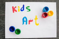 Inscription Kids art on white paper, colored inks. Kids art concept Royalty Free Stock Photo
