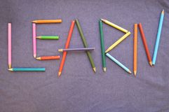 The inscription `learn` is written in colored pencils. stock images