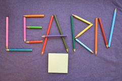 The inscription `learn` is written in colored pencils. stock photos
