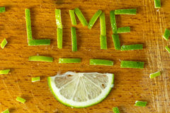 The inscription of lime lemon peel on wooden chopping board stock illustration