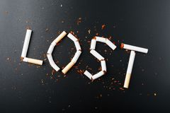 The inscription LOST from cigarettes on a black background. Stop smoking. The concept of smoking kills. Motivation inscription to. Quit smoking, unhealthy habit stock images