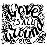 Inscription - Love is all around. Lettering design. Handwritten Stock Photo