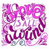 Inscription - Love is all around. Lettering design. Handwritten Stock Photos