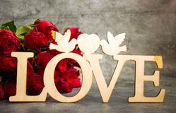 The inscription Love carved out of wood stock photo