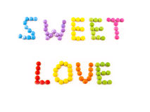 Inscription love from coloured chocolate candy Stock Photos