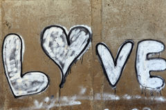 Inscription love on a concrete wall stock photography