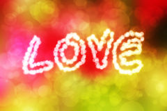Inscription love with defocused lights on abstract colorful boke. H background Stock Image