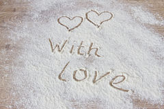 The inscription With love from flour. On a wooden table Royalty Free Stock Image