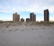 Inscription Love God of seashells in the sand on the coast. Royalty Free Stock Photo
