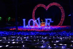 Inscription love and heart made of LEDs, in a city park, shot at night. The inscription love and the shape of the heart of the LEDs, which were installed in a stock images