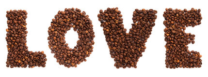 Inscription love of roasted coffee beans isolated. On white background Stock Photos