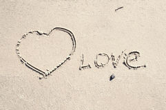 Inscription love on the sand Stock Photo