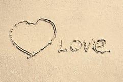 Inscription love on the sand Stock Photo