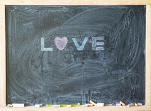 the inscription love on the school Board Valentine`s day Royalty Free Stock Images