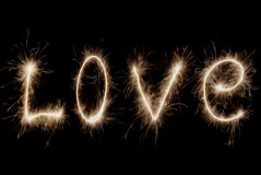 Inscription - Love of sparklers. Royalty Free Stock Image