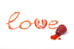 Inscription LOVE from strawberry. Jam and a fresh strawberry on the white background Stock Images