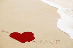 Inscription of Love on wet yellow beach sand Royalty Free Stock Image