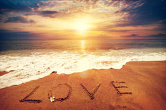 Free Inscription LOVE Written On The Sandy Beach With Ocean Wave - Sunset Time. Stock Photography - 88748422