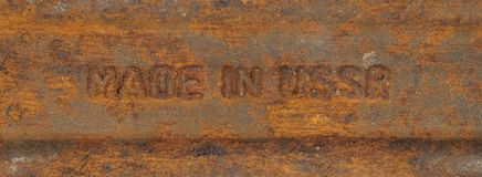 The inscription made in the USSR on a rusty metal Stock Photo