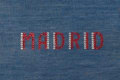 Inscription Madrid, inlaid rhinestones on denim. Stock Photography