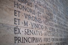 Inscription on a marble slab in Rome with the detail on Virgines royalty free stock images