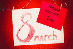 The inscription March 8 lip gloss on white paper and card with inscription Happy Women`s Day. Militant feminism concept stock photos