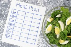 Inscription Meal Plan, schedule on white sheet, concept of weight loss. View from above. An inscription Meal Plan, schedule on white sheet, concept of weight stock photo