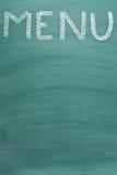 Inscription menu on chalkboard. Inscription menu on a chalkboard Royalty Free Stock Photos