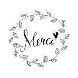 Inscription Merci with hand drawn floral wreath Stock Images