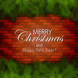 Inscription Merry Christmas on a brick wall Stock Images