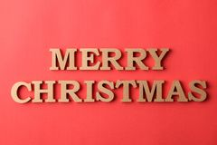 Inscription Merry Christmas. gold letters on a red background. holidays. Christmas. Inscription Merry Christmas. gold letters on a red background. holidays stock photography