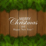 Inscription Merry Christmas on a wooden background Royalty Free Stock Images