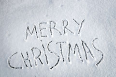 Inscription Merry Christmas written on snow Stock Images