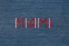 Inscription Miami, inlaid rhinestones on denim. Royalty Free Stock Image