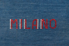 Inscription Milano, inlaid rhinestones on denim. Stock Images