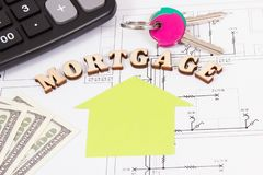 Inscription mortgage, currencies dollar, keys and calculator on construction housing plan, calculations of buying house concept. Inscription mortgage, currencies royalty free stock photo