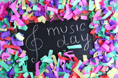 Inscription Music Day. On blackboard with colourful confetti Royalty Free Stock Images