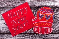Inscription New Year and gingerbread. Winter sweet red glove. Sweet congratulations stock photography
