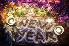"The inscription ""New Year"" in the snow. Royalty Free Stock Photos"