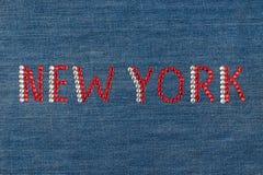 Inscription New York, inlaid rhinestones on denim. Stock Image