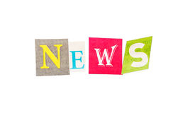 Inscription  News made from multicolored letters cut out  newspaper isolated. Royalty Free Stock Photo