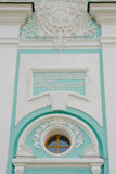 The inscription on the Old Russian language over the entrance to the bell tower of the Trinity-Se Stock Photo