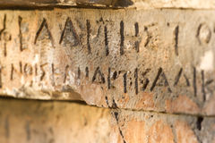 Inscription on old tomb in the Greek language. Characters, symbols. Hieroglyphs Royalty Free Stock Photography